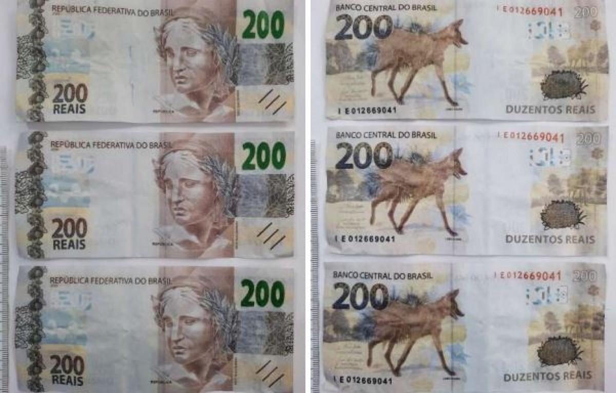 Laudo da Criminalística atesta que grupo estava com sete notas falsas de R$ 200 (Foto: SSP/SE)